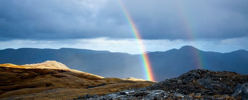 Rainbow across the Twelve Ben mountains, Connemara, County Galway,  Ireland.