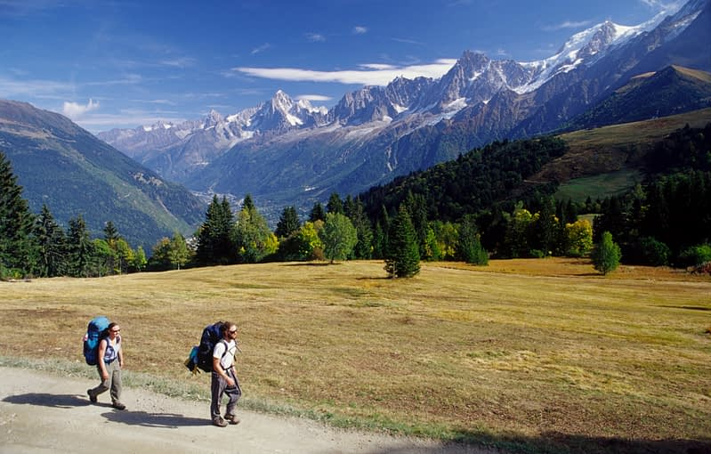 Walkers at the Col de Voza, Tour of Mont Blanc, French Alps, France.