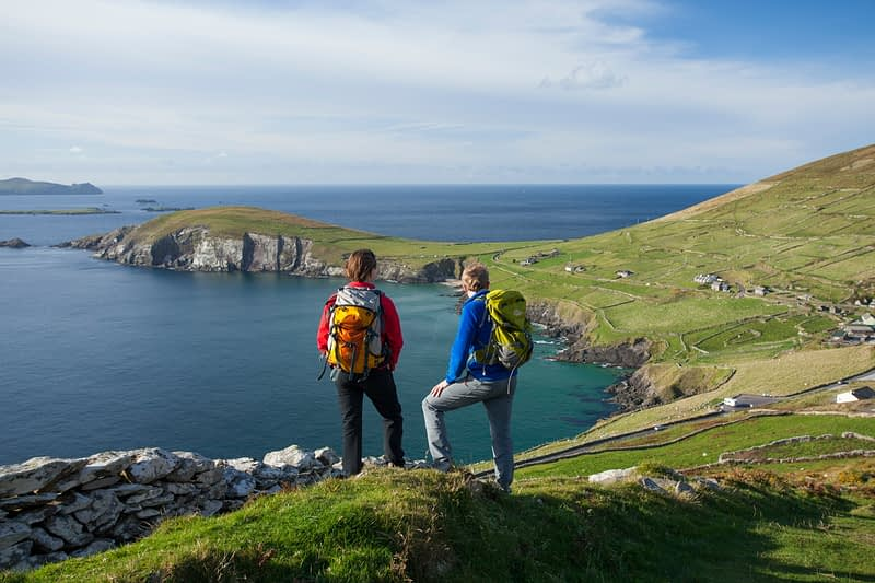 Walkers on the Dingle Way above Slea Head, Dingle Peninsula, County Kerry, Ireland.
