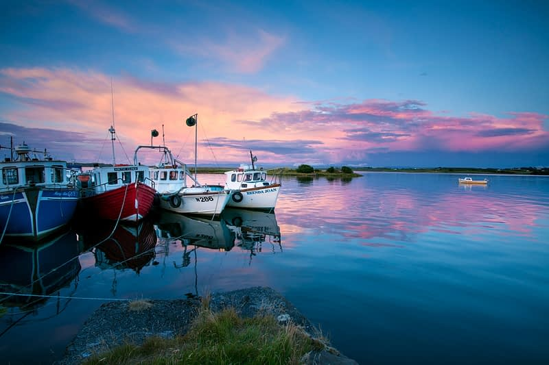 Evening fishing boats beside Killala pier, County Mayo, Ireland.