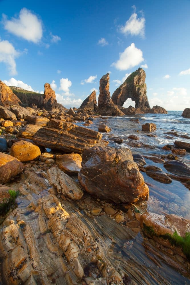 Evening light on the rock formations of Crohy Head, County Donegal, Ireland.