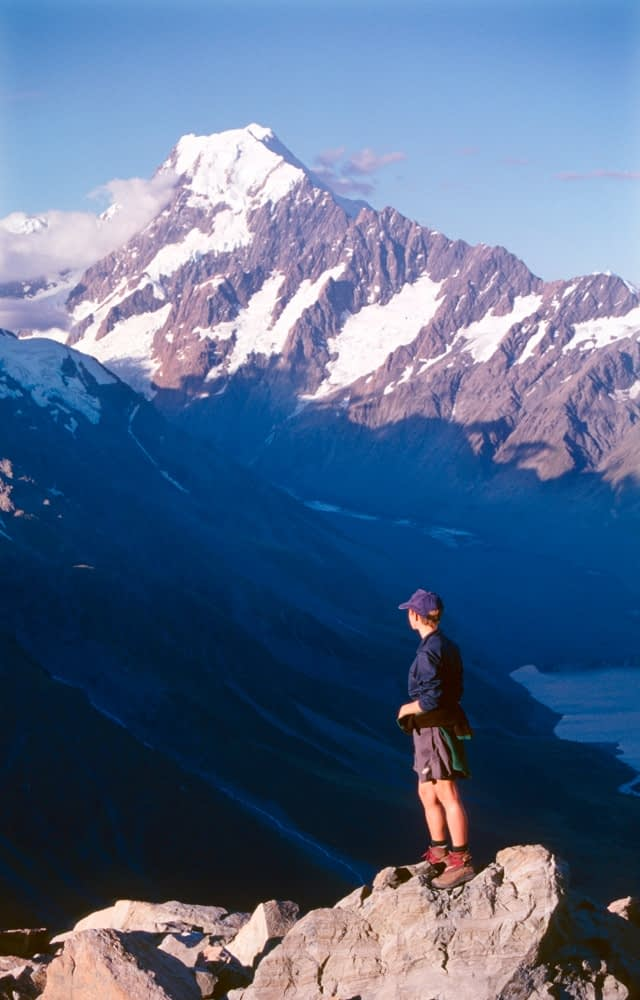Hiker beneath Aoraki / Mt Cook, Mt Cook National Park, New Zealand.