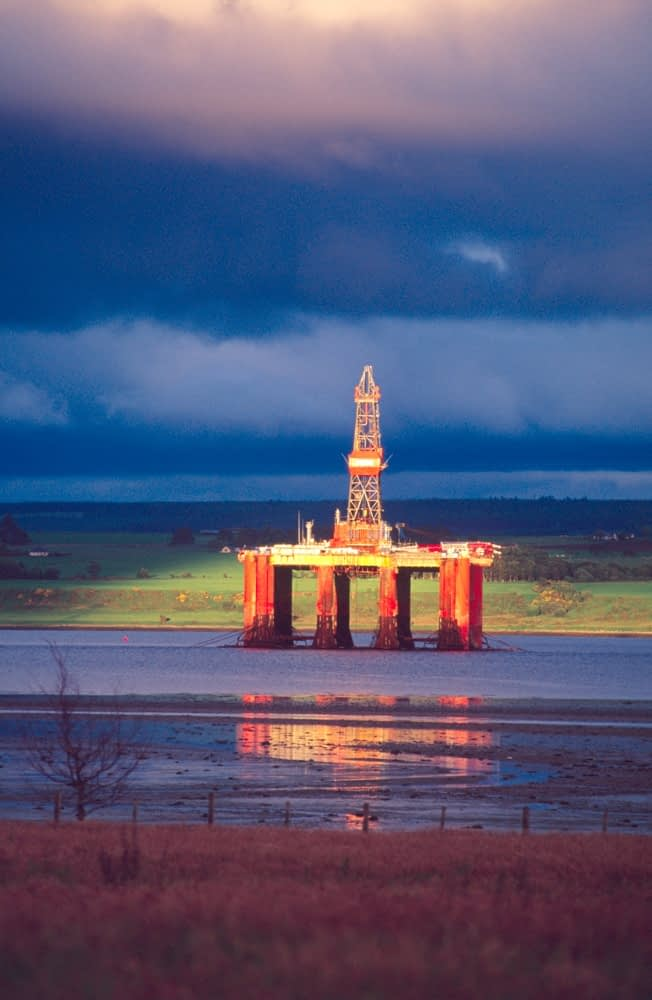 Oil rig in vivid storm light, Cromarty Firth, Scotland.