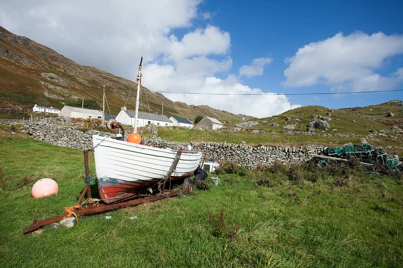 Fishing boat and cottages, Muckross Head, County Donegal, Ireland.