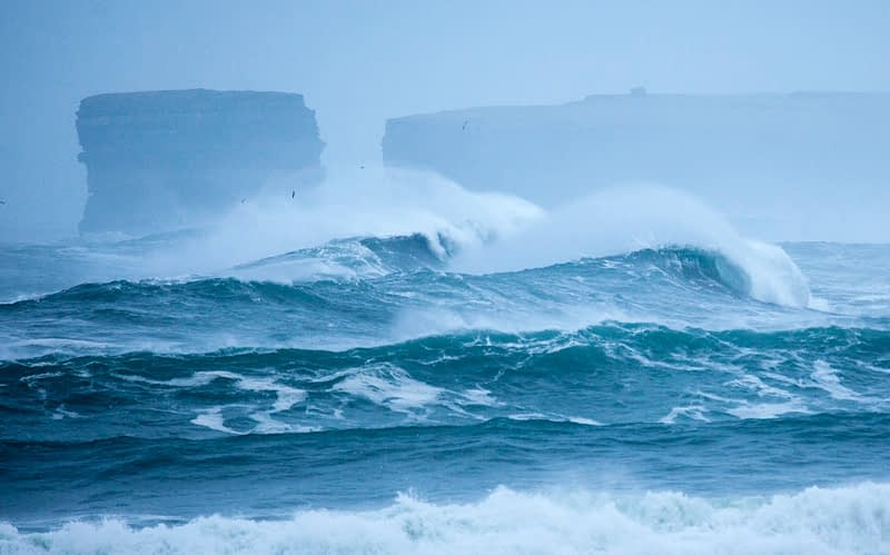 Storm waves breaking beneath Downpatrick Head, County Mayo, Ireland.
