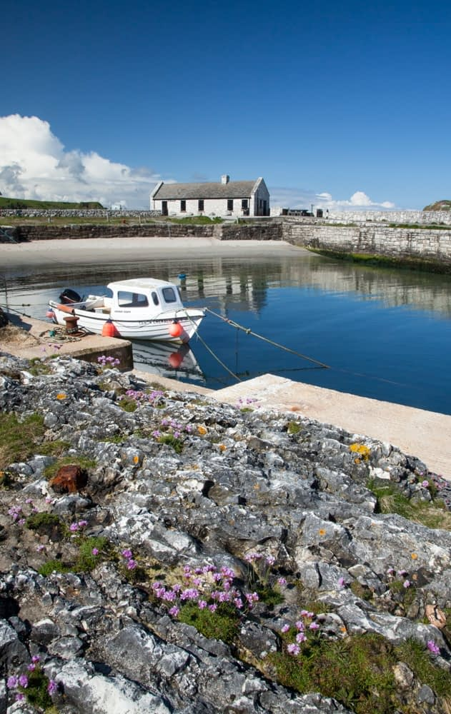 Fishing boat in Ballintoy Harbour, Causeway Coast, County Antrim, Northern Ireland.