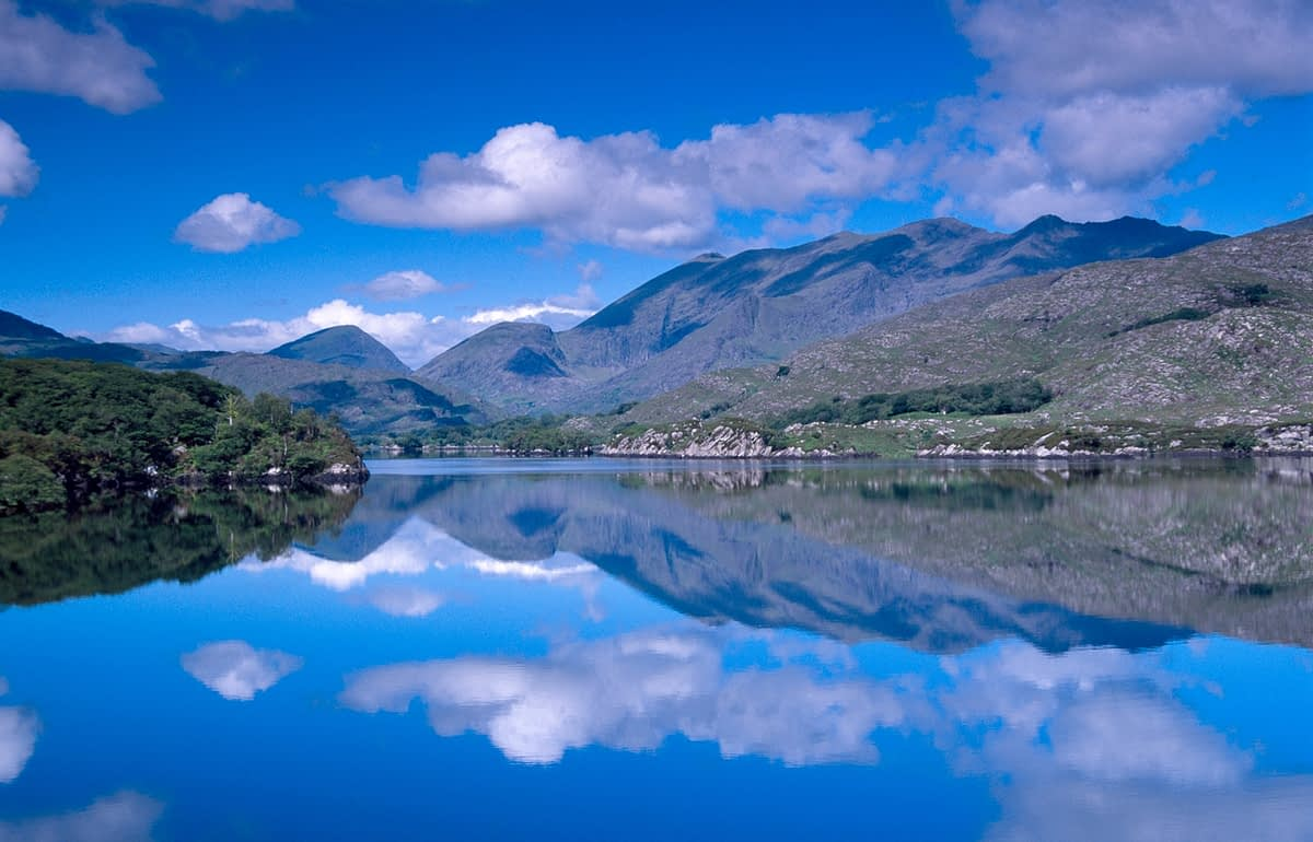 MacGillycuddy's Reeks reflected in Upper Lake, Killarney National Park, Co Kerry, Ireland.