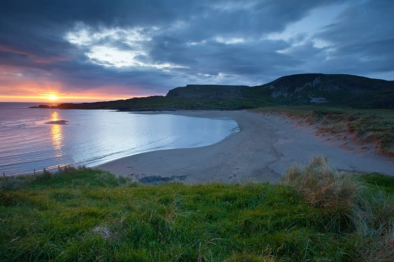 Sunset over Glencolmcille beach and Glen Head, Co Donegal, Ireland.