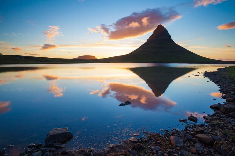 Sunset reflection of Kirkjufell mountain, Grundarfjordur, Snaefellsnes Peninsula, Vesturland, Iceland.