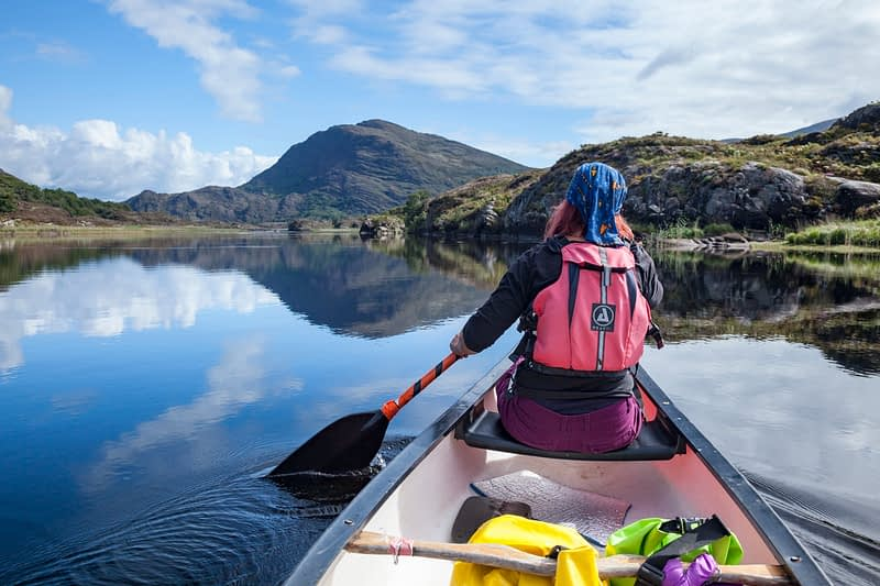 Canoeing on Upper Lough, Killarney Lakes, Killarney National Park, County Kerry, Ireland.
