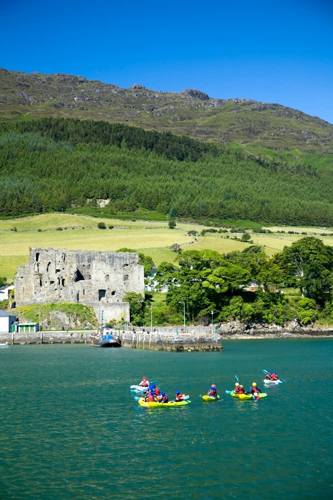 Kayaking near Carlingford harbour, Co Louth, Ireland.