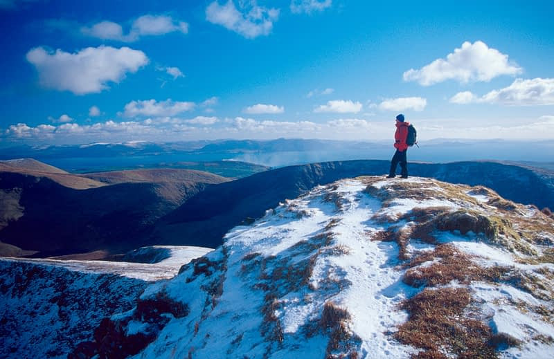 Winter walker on the summit of Gearhane, Brandon massif, Dingle Peninsula, Co Kerry, Ireland.