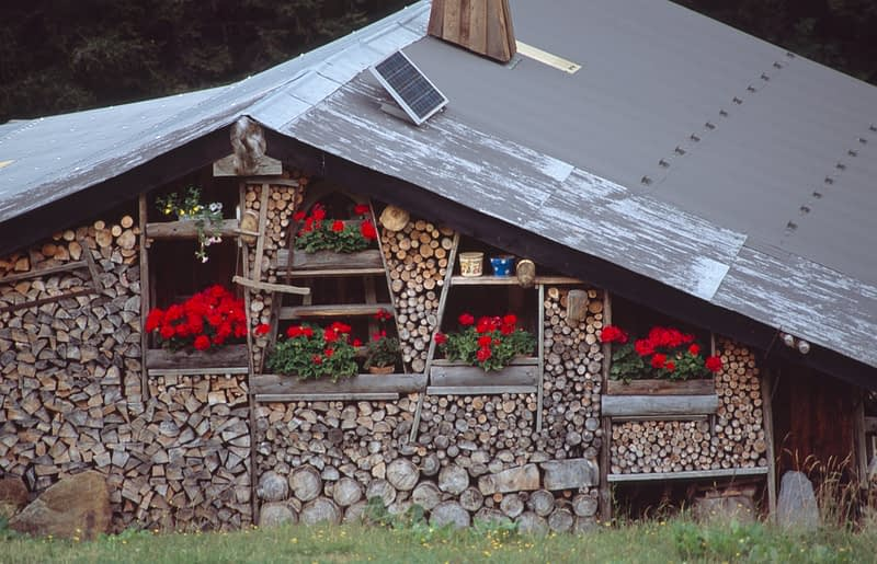 Firewood stacked against an alpine chalet, Chamonix Valley, French Alps, France.