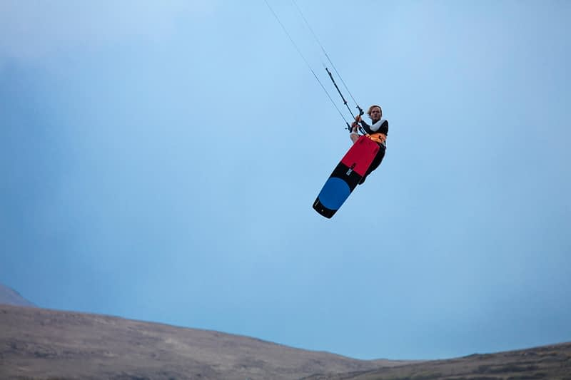 Kitesurfer Francois Colussi launching an aerial, Keel Lough, Achill Island, County Mayo, Ireland.