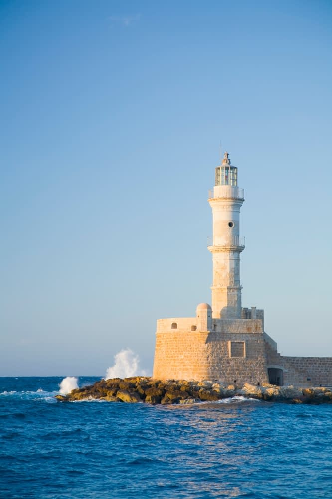 The Venetian lighthouse at the entrance to Hania harbour, Crete, Greece.