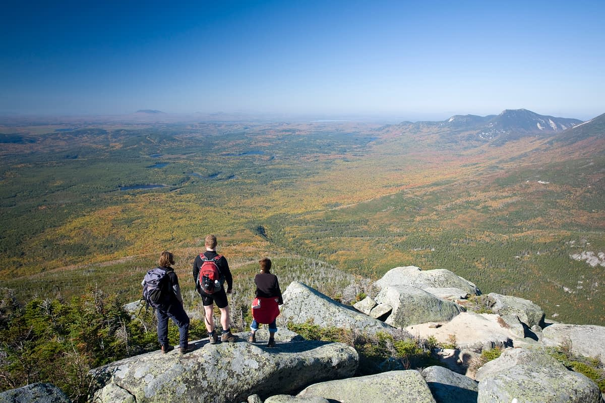 Hikers looking out from Mount Katadhin, Baxter State Park, Maine, USA.