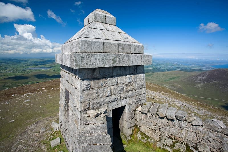 Stone shelter at the summit of Slieve Meelmore, Mourne Mountains, Co Down, Northern Ireland.