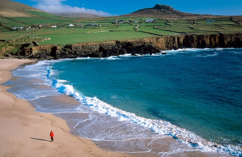 Person walking on Clogher Beach, Dingle Peninsula, Co Kerry, Ireland.