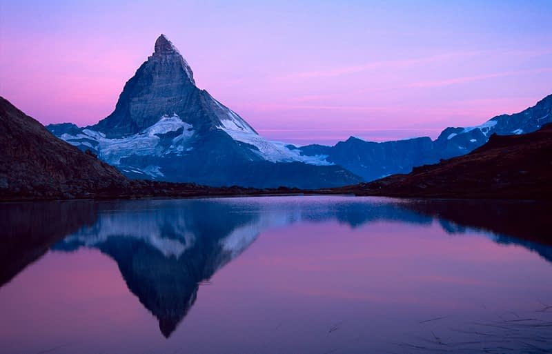 Dawn reflection of the Matterhorn, Riffelsee, Valais, Swiss Alps, Switzerland.