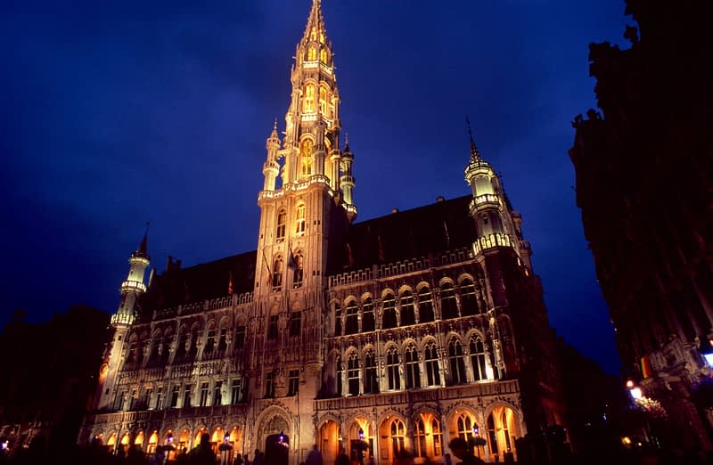 Hotel de Ville in Grand Place at dusk.