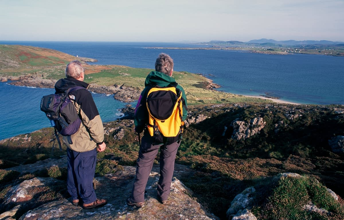 Walkers looking across Melmore Head from Melmore Hill, Rosguill Peninsula, County Donegal, Ireland