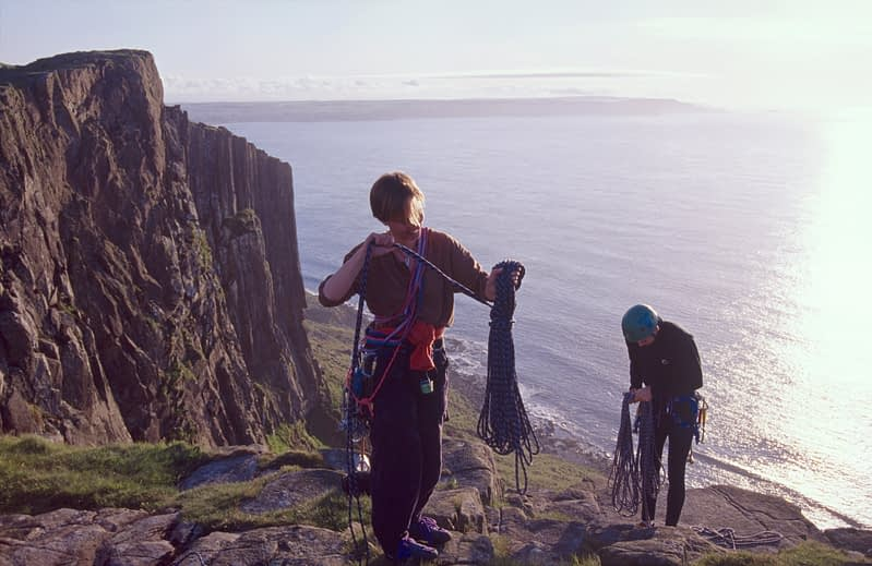 Rock climbers at the cliffs of Fair Head, Co Antrim, Northern Ireland.