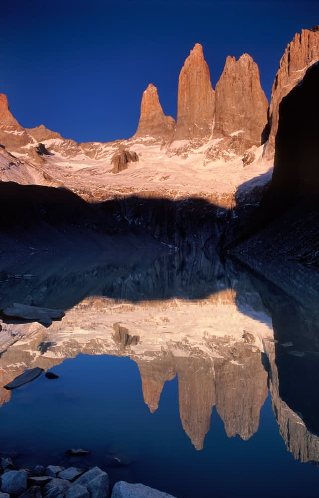 Dawn reflections of the Torres del Paine, Torres del Paine NP, Patagonia, Chile.