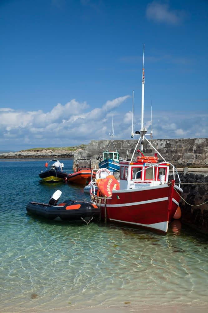 Boats moored beside the pier on Inishkea South Island, County Mayo, Ireland.