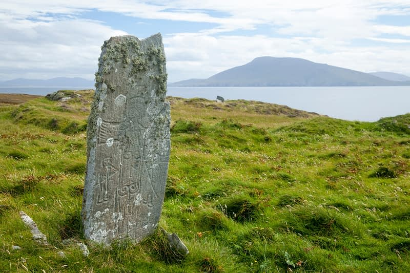 Early Christian carved pillar on Duvillaun More island, County Mayo, Ireland.