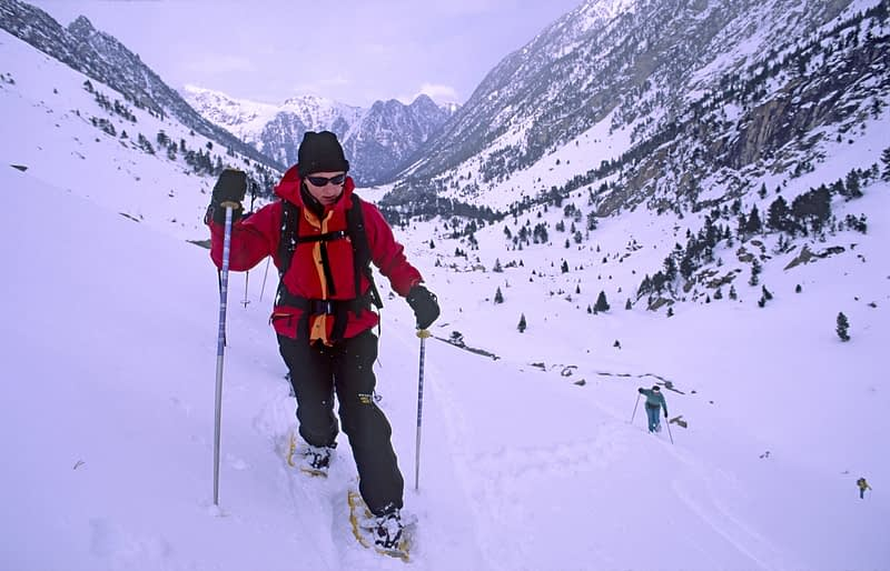 Snowshoeing in the Vallee de Gaube, Parc National des Pyrenees, France.