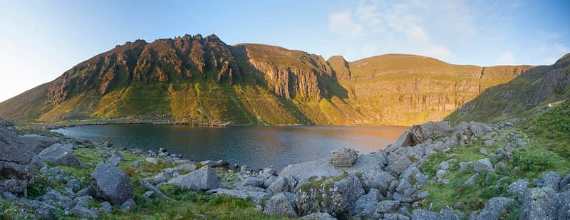 Dawn light illuminates Coumshingaun, Comeragh Mountains, County Waterford, Ireland.