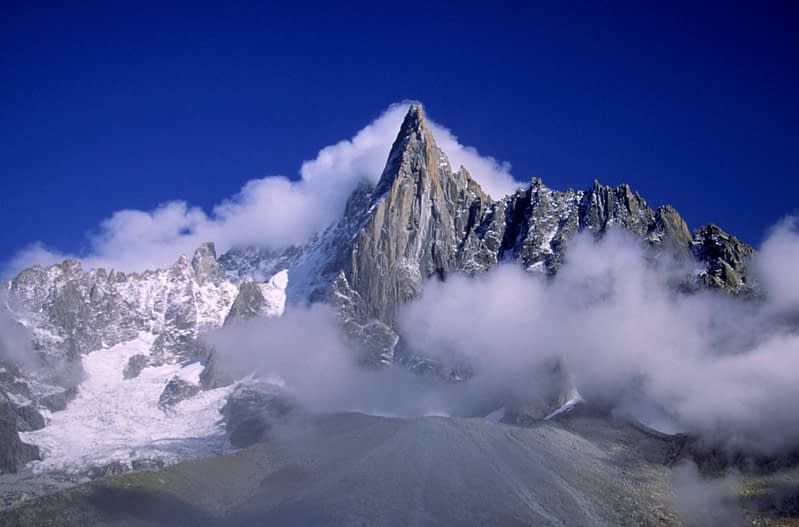 The Aiguille Vert above swirling cloud, Mt Blanc massif, French Alps, France.