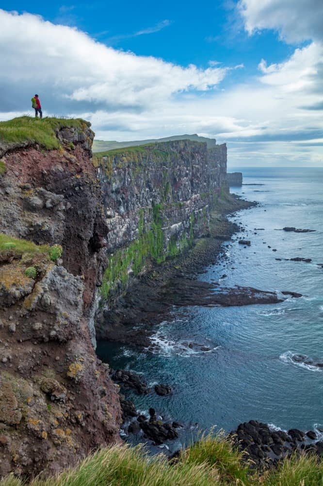 Person on top of the Latrabjarg bird cliffs. Latrabjarg Peninsula, Westfjords, Iceland.