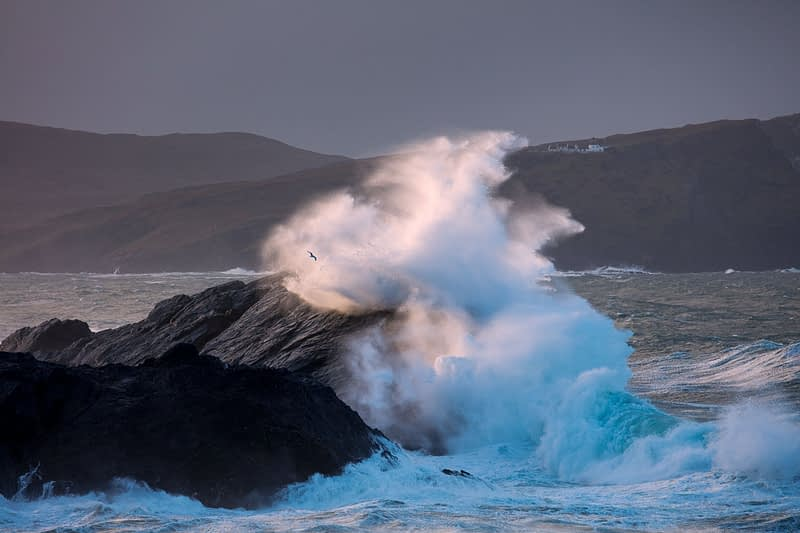 Storm waves beneath Clare Island lighthouse, Achill Island, County Mayo, Ireland.
