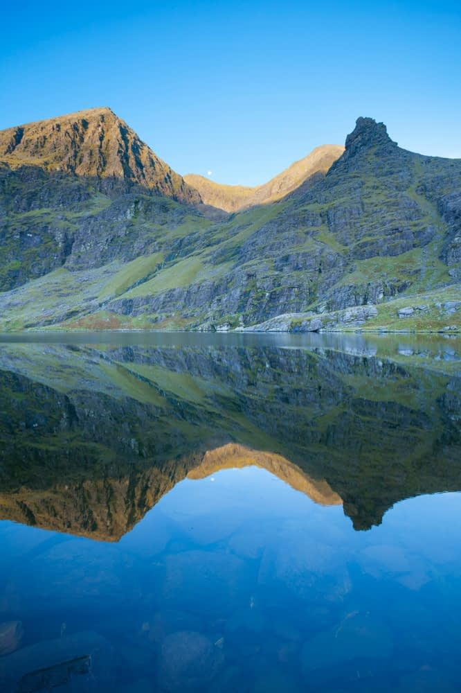 Carrauntoohil and Beenkeragh reflected in the waters of Lough Gouragh, Hag's Glen, MacGillycuddy's Reeks, County Kerry, Ireland.