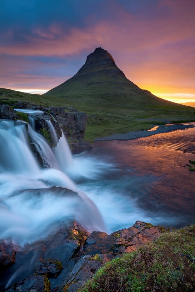 Dawn over Kirkjufell mountain and waterfall, Grundarfjordur, Snaefellsnes Peninsula, Vesturland, Iceland.