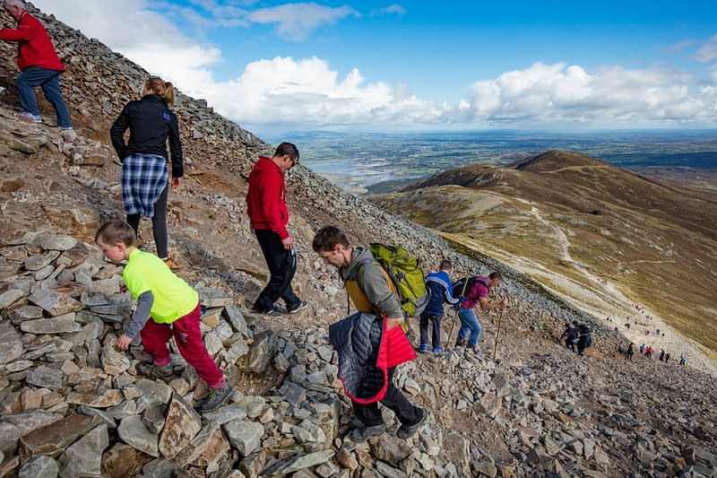 Hikers climbing Croagh Patrick, County Mayo, Ireland.