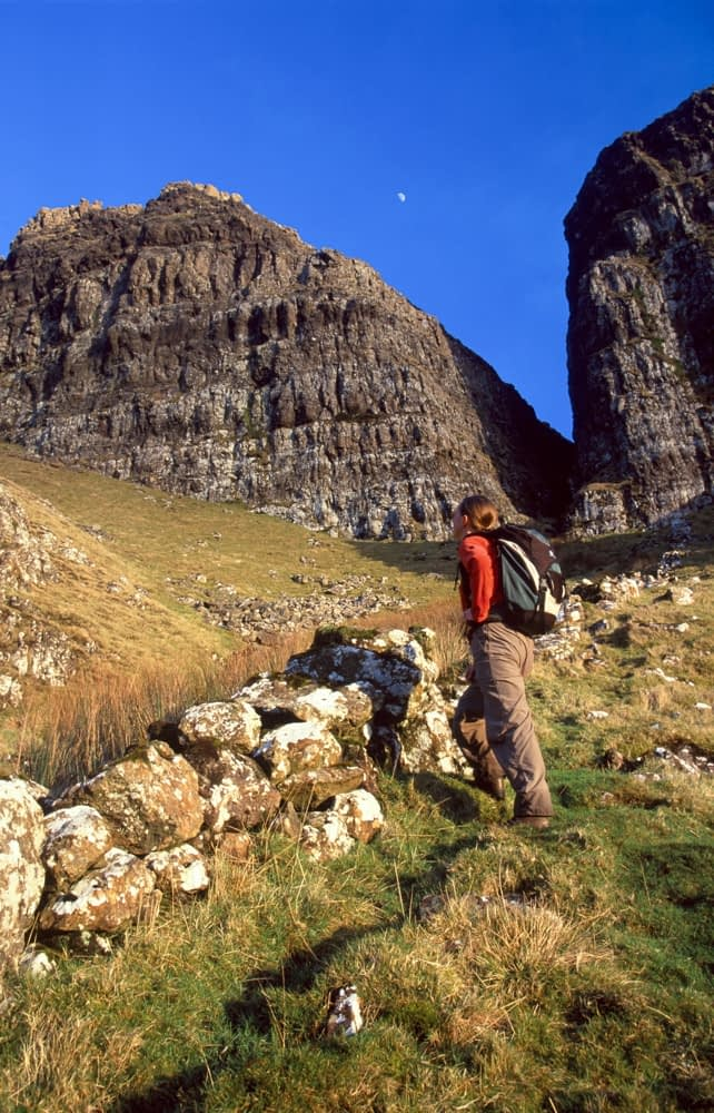 Evening walker beneath the cliffs of Binevenagh, Co Derry, Northern Ireland.