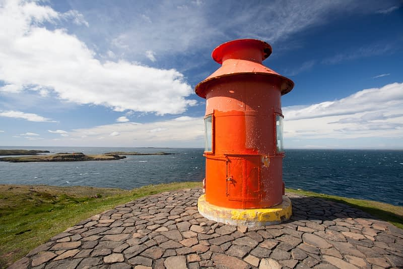 Lighthouse protecting the mouth of Breidafjordur, Sugandisey island, Stykkisholmur, Vesturland, Iceland.