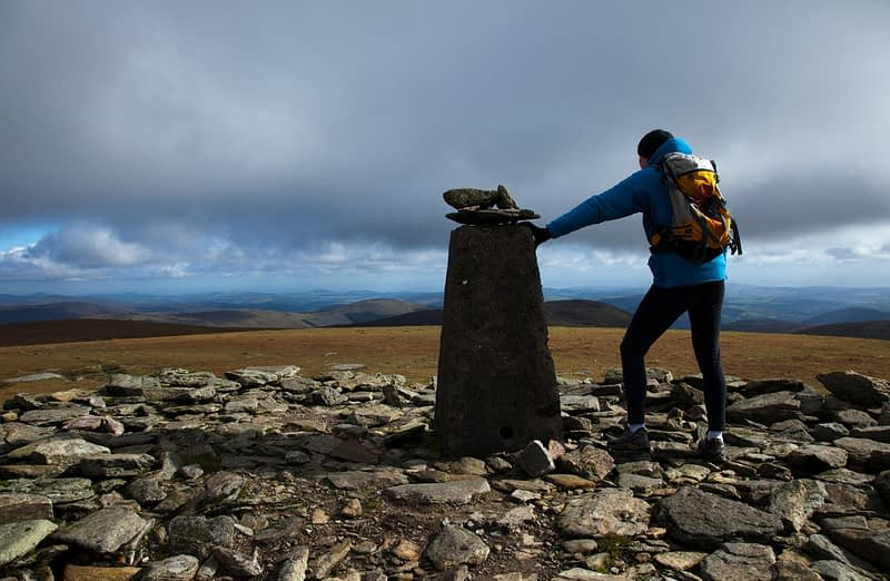 Walker at the summit of Lugnaquilla (925m), Wicklow Mountains, County Wicklow, Ireland.