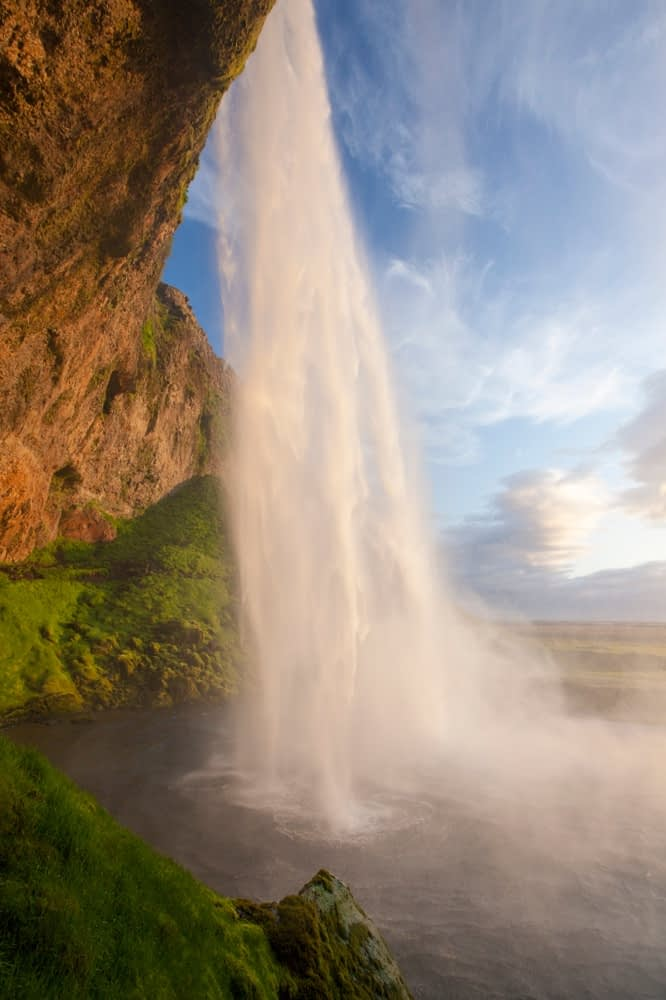 Seljalandsfoss waterfall plunging 60m from the cliff above, Sudhurland, Iceland.