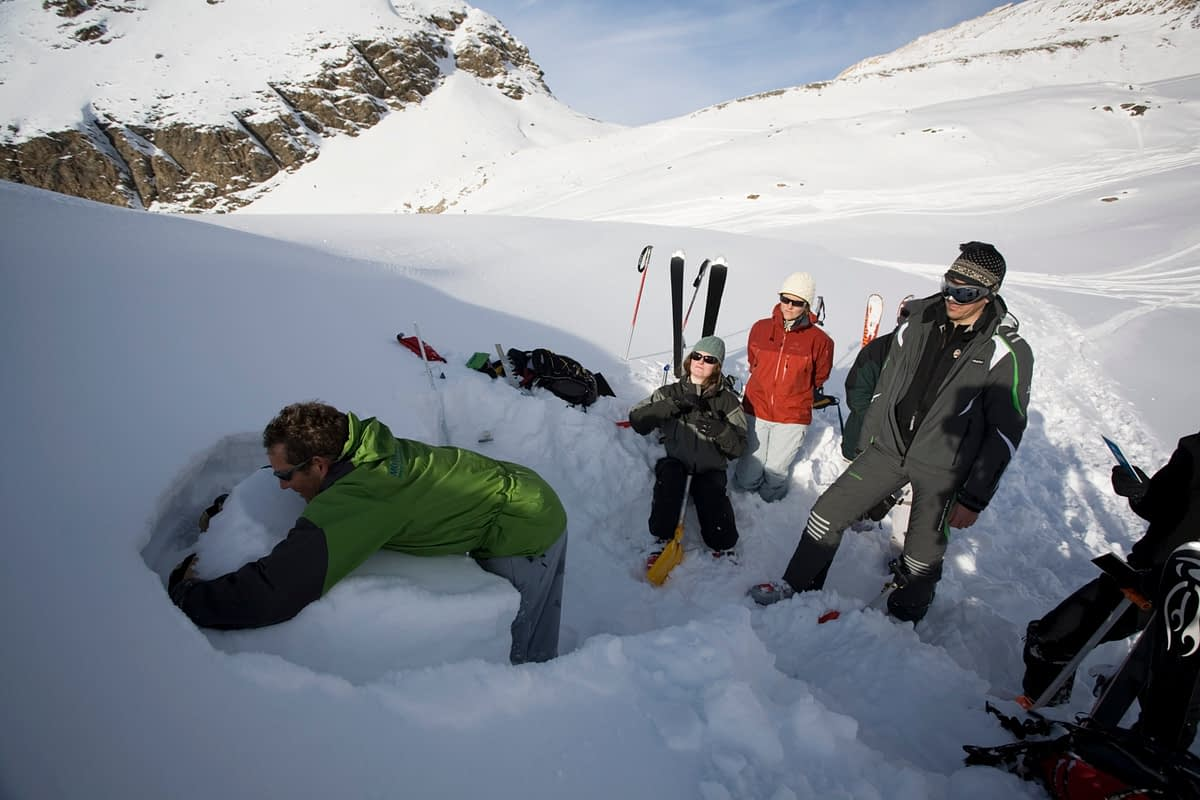 Snowpack assessment during avalanche safety training, French Alps, France.