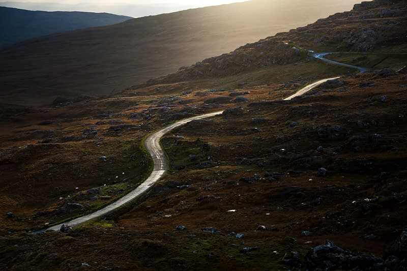 Twisty road climbing to the Healy Pass, Beara Peninsula, County Cork, Ireland.