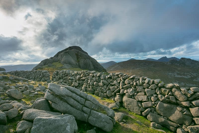 The Mourne Wall at the summit of Slieve Binnian, Mourne Mountains, County Down, Northern Ireland.
