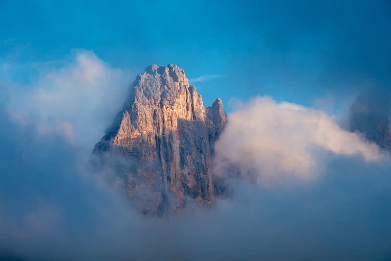 Evening cloud swirls around Cime Grande, Tre Cime di Lavaredo, Sexten Dolomites, South Tyrol, Italy.