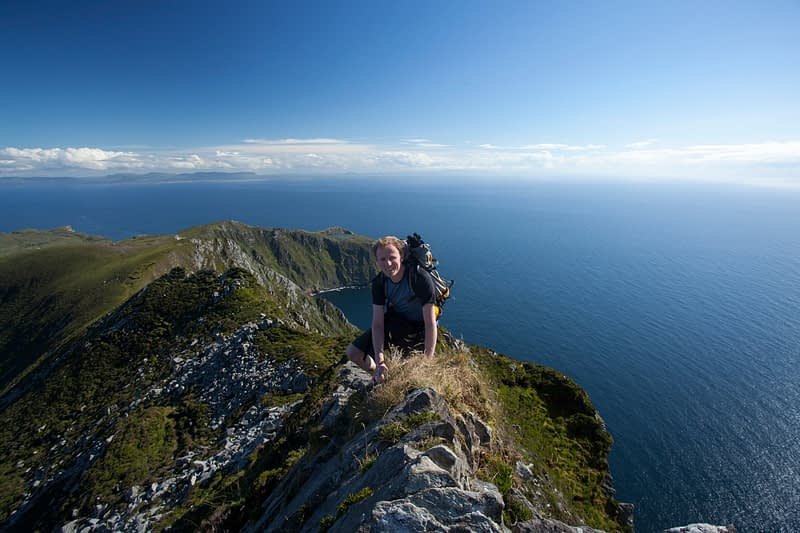 Hiker negotiating One Man's Pass, Slieve League, County Donegal, Ireland.