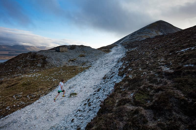 Triathlete Con Doherty running up Croagh Patrick, County Mayo, Ireland.