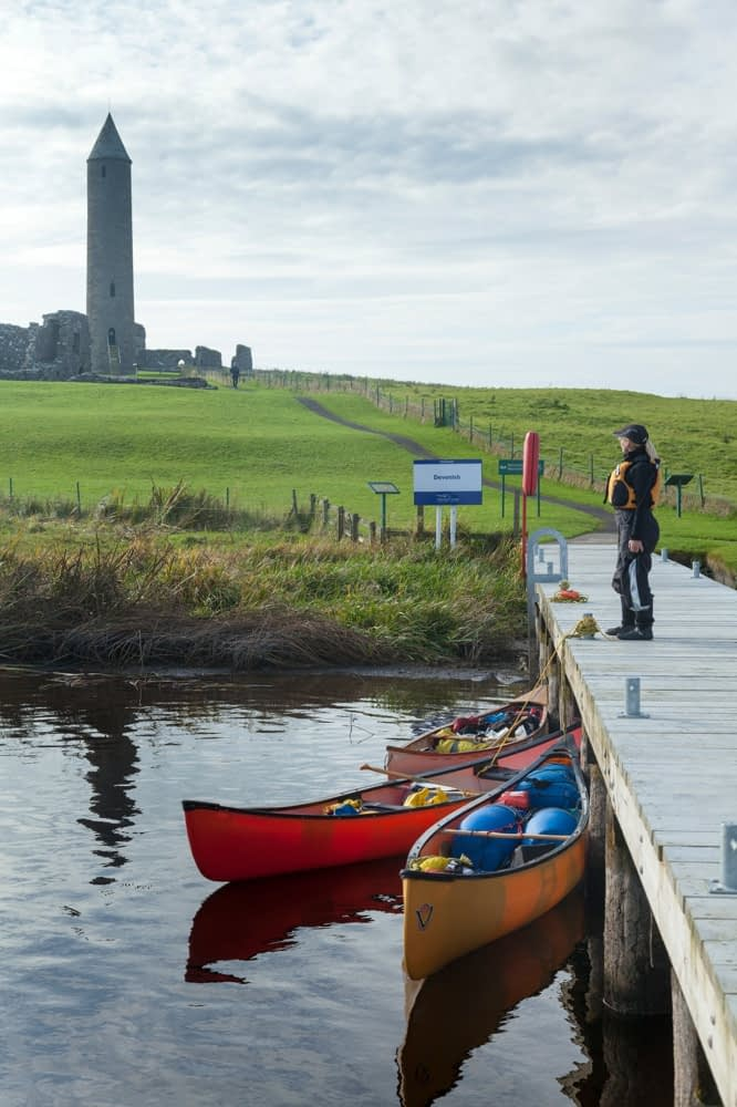 Canoeist at Devenish Island jetty, Lower Lough Erne, County Fermanagh, Northern Ireland.