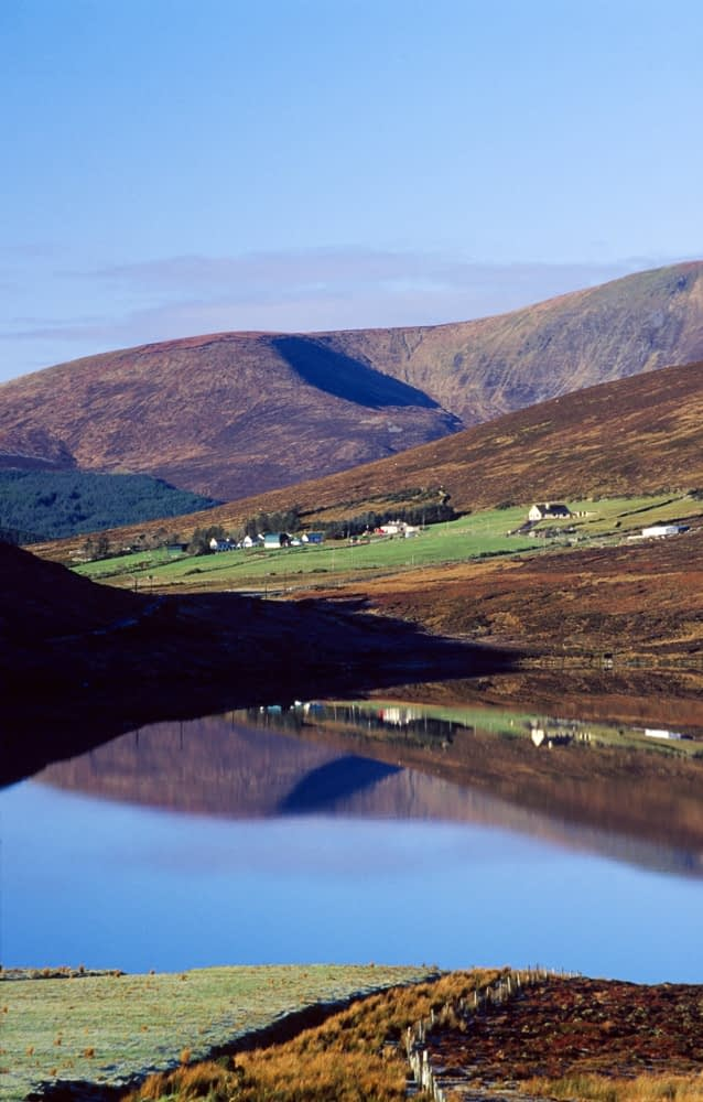Lough and cottages in the Nephin Beg Mountains, Co Mayo, Ireland.