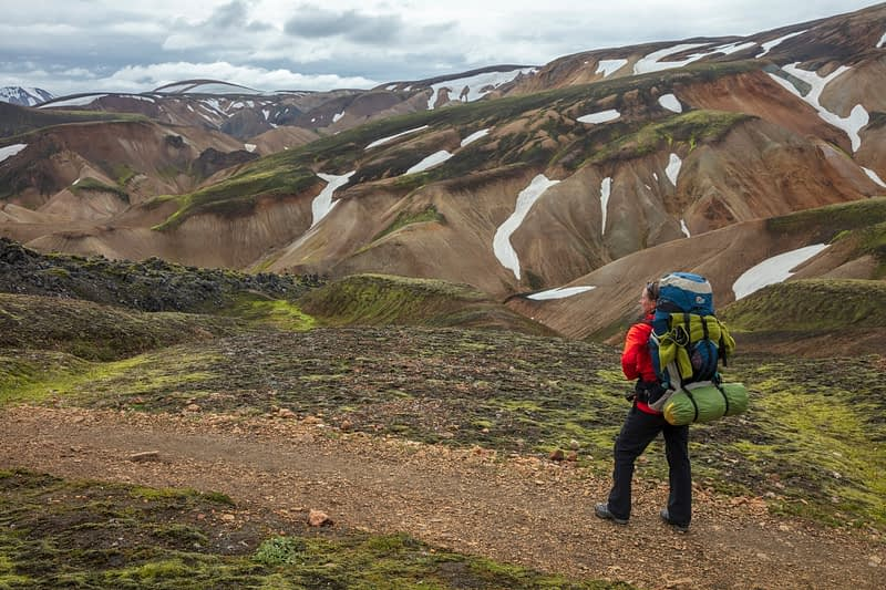 Hiker on the Laugavegur trail near Landmannalaugar. Central Highlands, Sudhurland, Iceland.